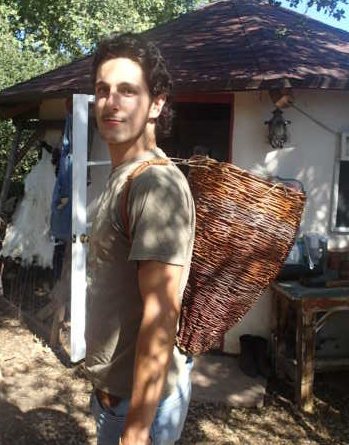 Sespe Miller wearing a tradiitoinal Chumash willow basket