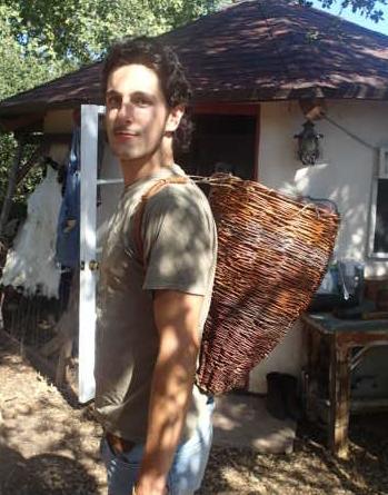 Sespe Miller wearing a tradiitoinal Chumash willow basket